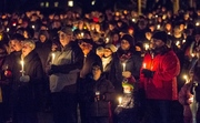 Amid hundreds of flickering candles, sisters remembered at vigil