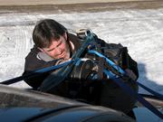 DP Steve McCarthy fixes camera on car mount Alaska Highway shoot