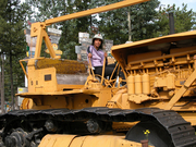 Tracy on a D8 Caterpillar during Alaska Highway scout