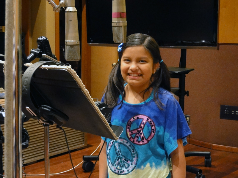 """Amanda Rodriguez recording the animated TV special, """"Jingle and Bell's Christmas Star"""""""