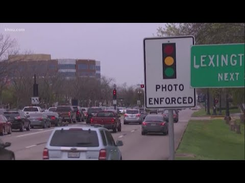 Gov. Abbott signs law banning red light cameras in Texas