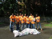 Youthbuild participants clean up trash along the creek