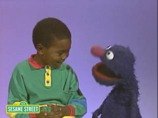 Grover & a child discuss marriage