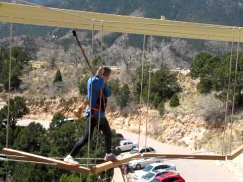 "Matt Carpenter crosses a tricky ""element"" on the Windwalker ropes course at Cave of the Winds"