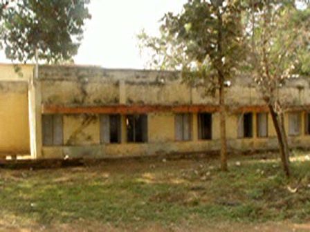 side view of New Dormitory and the play ground behind it
