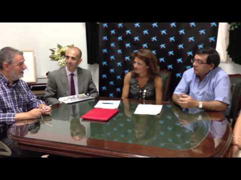 Firma convenio La Caixa con COAGU