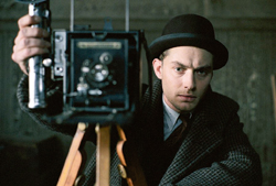 Jude Law as the assassin/photographer in Road to Perdition (Sam Mendes 2002). In Photography and Cinema David Campany assembles a missing history in which photography and cinema have been each other's muse and inspiration for over a century. From Photography and Cinema by David Campany (Reaktion Books). © Dream Works