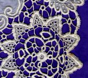 Needle lace collar close up