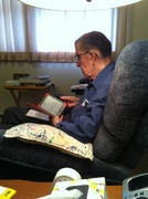 dad reading his new kindle