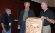 Clint Eastwood give Joel Cox award