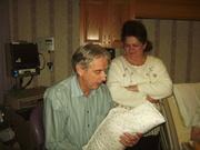 Holding newborn.