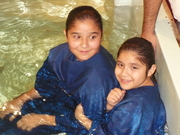 Melody and Harmony being baptized