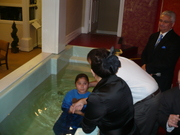 Melody being baptized
