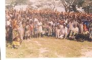 These are some of the orphans from Viragoni village, Mwanamwinga location, Kaloleni District, pausing for a photograph together with their guasrdians ouside the Catholic church compound appealing for
