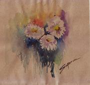three flowers on brown paper