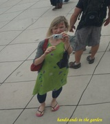 Green dress reflected in 'The Bean' in Chicago