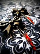 Deadly Dame knife earrings
