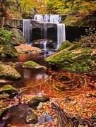 Fall symphony at a waterfall in Geauga County near Cleveland, Ohio.