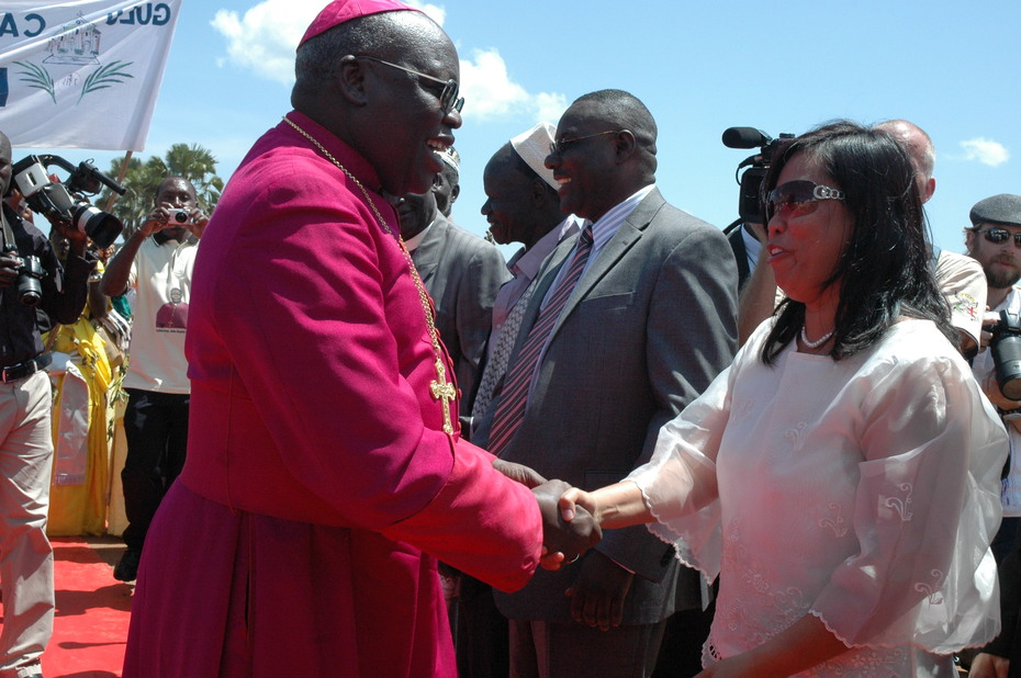 Archbishop Odama greets Maria Yvette Reyes