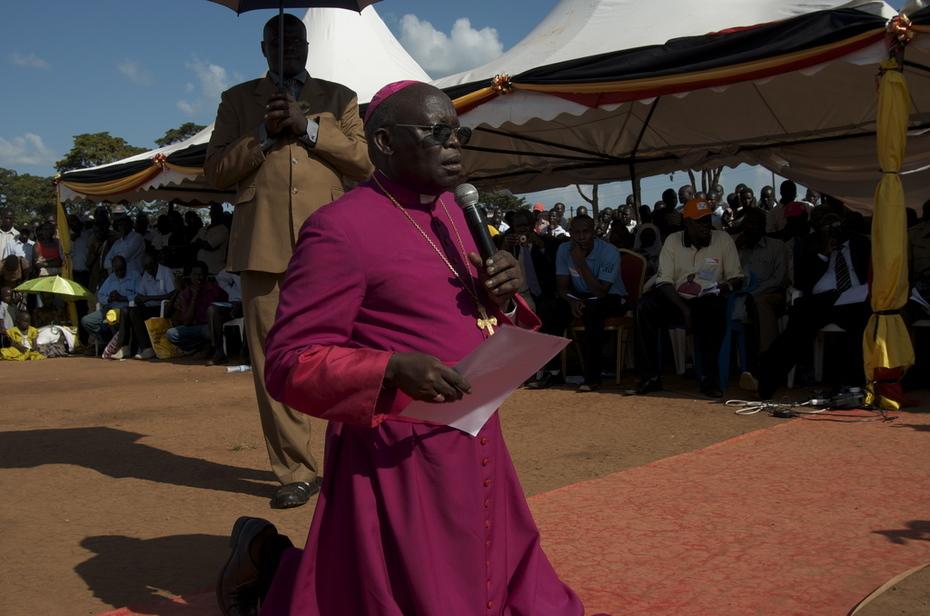 Archbishop Odama kneels
