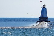 Ludington lighthouse and breakwater - rising water