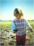 Mikayla playing in the mud