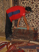 Berns taking stock, Persian carpets.