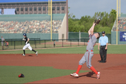 Pitcher Making Play On Pop-Fly