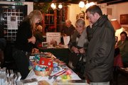 The Railway Bell Christmas 2010 - Kirsten's RNLI stall. Background - The Friends of Bushy & Home Parks