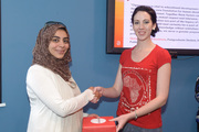 Louise Kruger from Bookmark hands over the prize to Open Access competition winner Quraysha Ismail Sooliman, Postgraduate Student, Department of Political Science