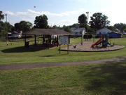 Families enjoying the new play ground.