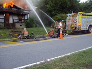 The fire department burning a old house
