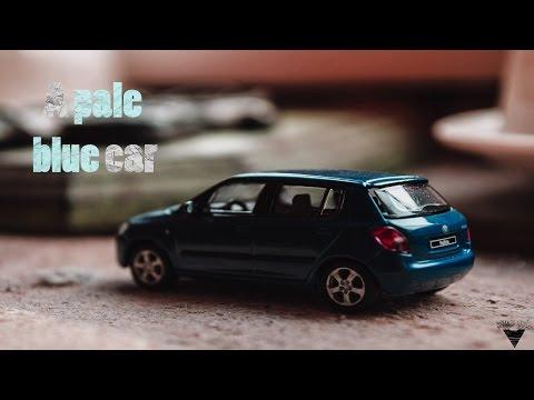 A PALE BLUE CAR