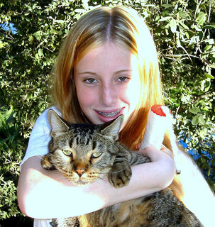 Girl with her cat (Flickr Creative Commons/Roy Montgomery)