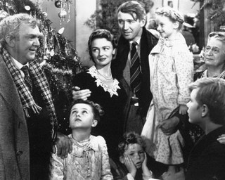 George Bailey reunited with his family in 'It's a Wonderful Life' (AP Photo)