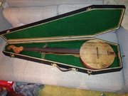Wooden face banjo and coffin case