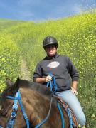 Ashley rides through the mustard that's taller then her!!