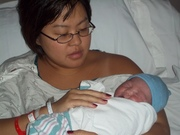 Mommy and Robert December 10th right after birth