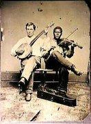 Confederate banjo player, 1865.