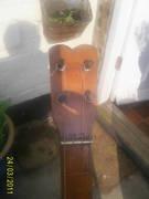 Cave banjo peghead