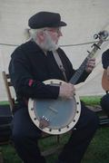 Dave with homemade banjo at private party by a lake 2014