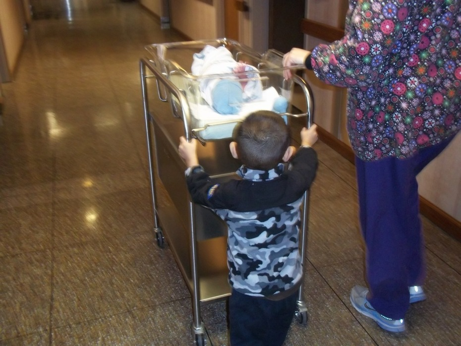 Danny pushing the cart to the nursery