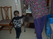 Daniel helping to take Robert to the Nursery for checkup and first bath