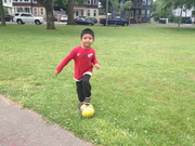 A boy plays with his soccer ball
