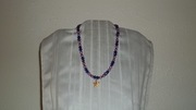 Irridescent Beads with light purple colored pears and starfish