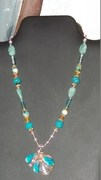 Seed beads, turquoise colored stones and pendant