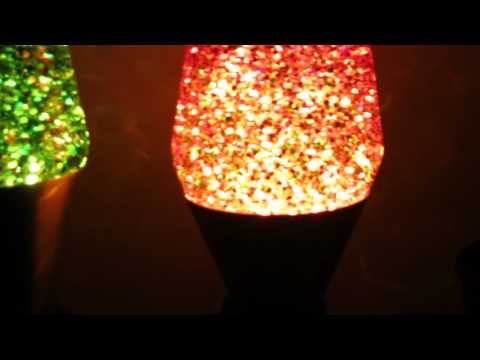 32oz and 52oz home made glitter lamps side by side