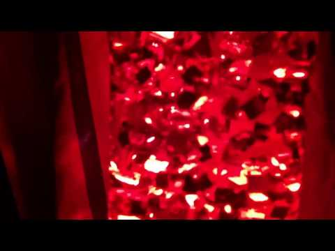 Custom Red Living Jewel Running in Jet Bottle with 25W Clear Bulb