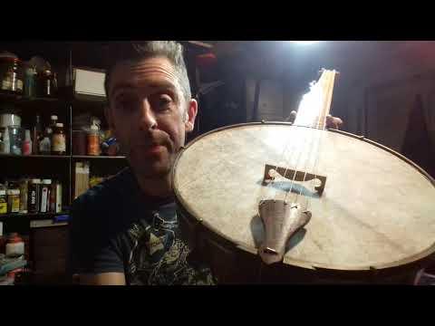 Minstrel banjo, horse head carving