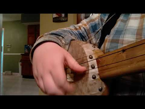 Old Johnny Boker on horse hair strung gourd banjo.